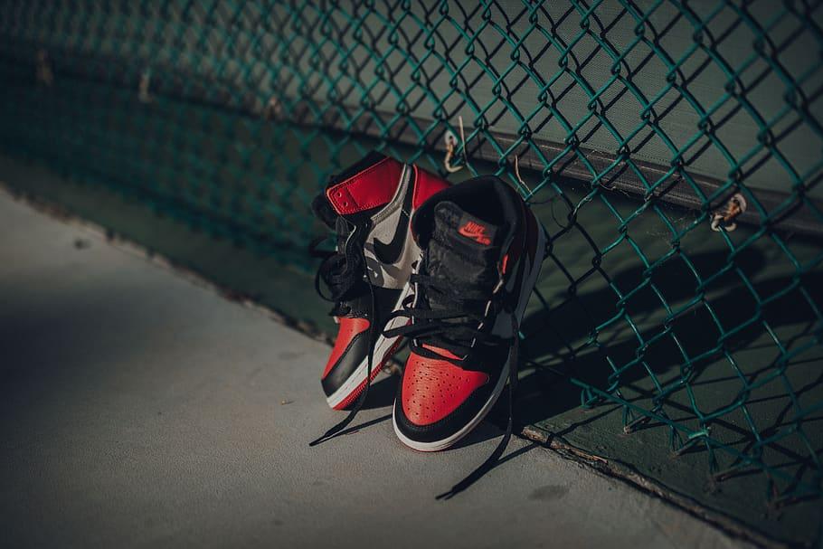 Nike Air Jordan 1 Shoes Near Chain Link Fence Apparel Jordan Shoes Wallpaper 4k 910x607 Wallpaper Teahub Io