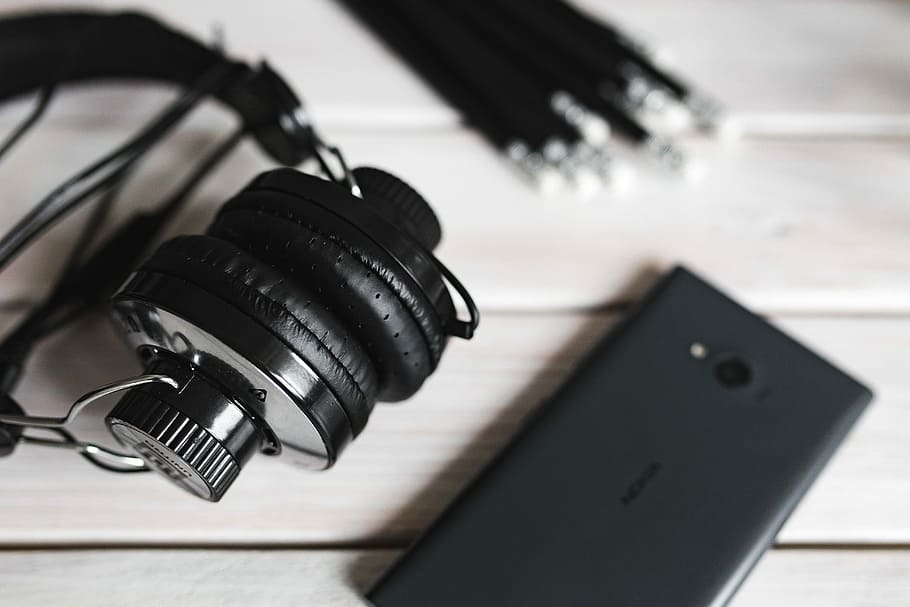 Black Smartphone And Headphones With Various Items, - Photography Music Earphones - HD Wallpaper