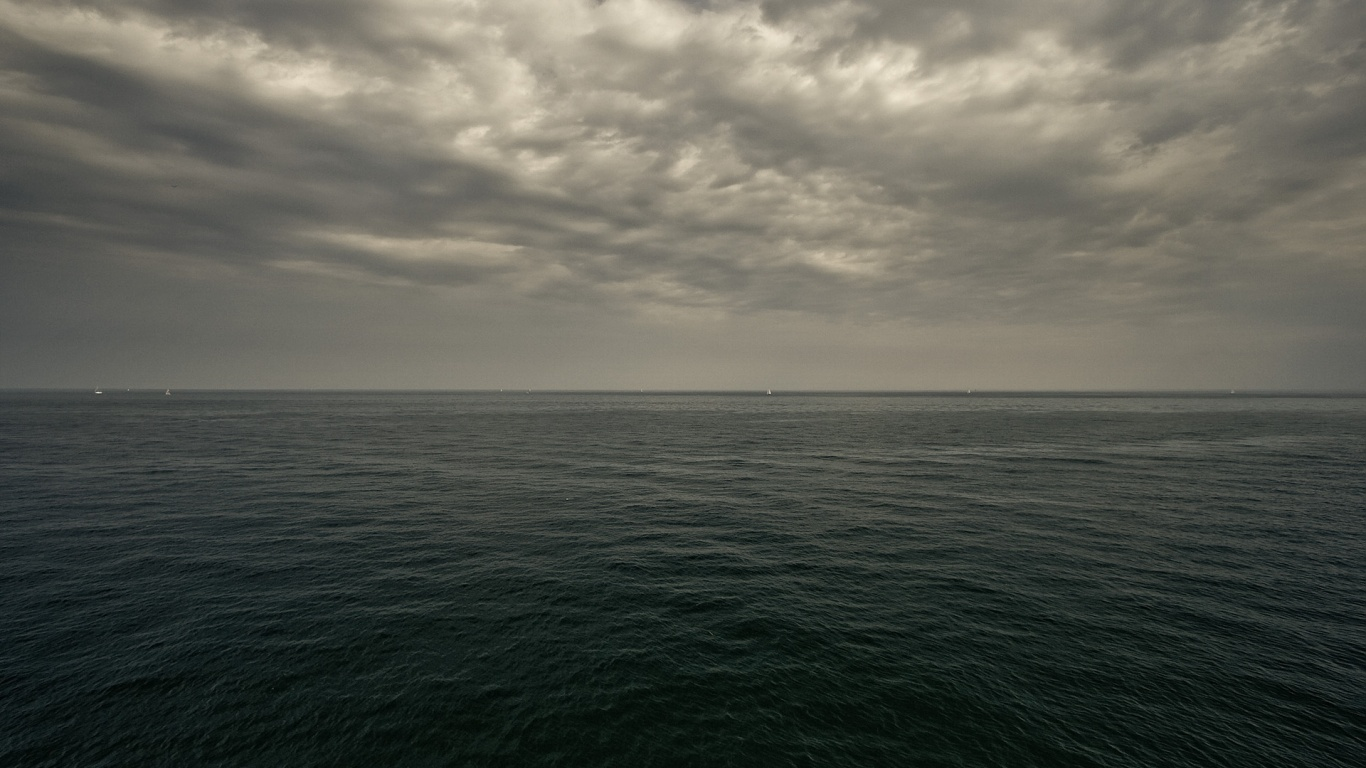 Sea And Dark Sky 1366x768 Wallpaper Teahub Io